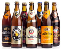 Collection of German wheat beers on white Royalty Free Stock Photo
