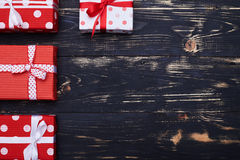 Collection of gift boxes arranged left side over grunge flat lay Stock Images