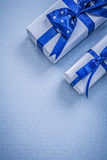 Collection of gift boxes on blue background holidays concept Royalty Free Stock Photos