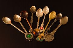 Collection of gift spoons from different countries. Collection of spoons from different countries Stock Photo