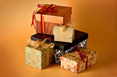 Collection of gifts. Isolated on orange background Royalty Free Stock Images
