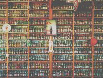 Collection of Glass Soda and Beer Bottles on Shelves Royalty Free Stock Image