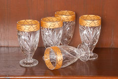 Collection of glasses with gold trim Royalty Free Stock Images