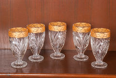 Collection of glasses with gold trim Royalty Free Stock Photos