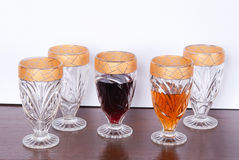 Collection of glasses with gold trim Royalty Free Stock Photo