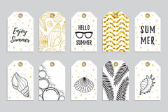 Collection of gold gift tags with glitter texture with starfishes and seashells Royalty Free Stock Images