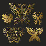 Collection of gold butterflies. Collection of gold openwork butterflies on a black background Stock Images