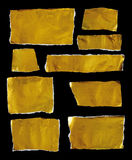 Collection of gold ripped pieces of paper on black background royalty free stock photography