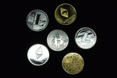 A collection of gold and silver cryptocurrency coins stock image