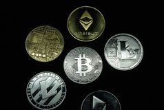 A collection of gold and silver cryptocurrency coins stock photography