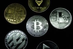 A collection of gold and silver cryptocurrency coins stock images