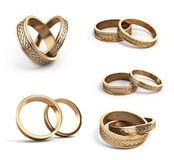 Collection of Gold wedding rings engraved 3d render on white Stock Photography