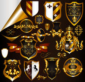Collection of golden elements arms or labels. Calligraphic vector Collection of golden elements arms or labels Royalty Free Stock Photo