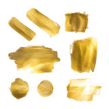 Collection of golden paint strokes to make a background for your Royalty Free Stock Images
