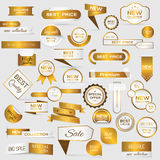 Collection of golden premium promo seals/stickers. Stock Photography