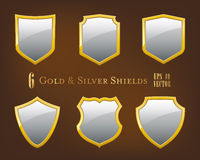 Collection of golden and silver shields Stock Photos