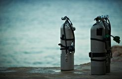 Collection of grey scuba diving air oxygen tanks. Collection of grey scuba diving air oxygen tanks waiting lined up stock photography