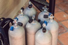 Collection of grey scuba diving air oxygen tanks waiting.  stock image