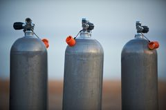 Collection of grey scuba diving air oxygen tanks. Collection of grey scuba diving air oxygen tanks waiting lined up stock photo
