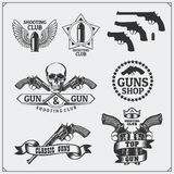 Collection of Gun club emblems, labels and design elements. Revolvers, bullets and target. Royalty Free Stock Photos