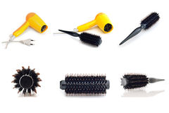 Collection hair dryer and comb brush isolate on white background. Collection hair dryer and comb brush, on table in beauty salon isolate on white background royalty free stock images