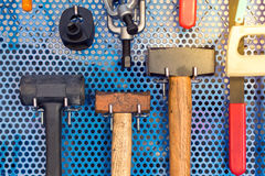 Collection of hammer tools tidy on board in garage Royalty Free Stock Photo