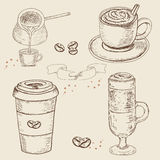Collection of hand drawn Sketch pictures of coffee cups. Royalty Free Stock Photo