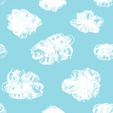 Collection of Hand Drawn Vector grunge Clouds on the blue background. Stock Photos