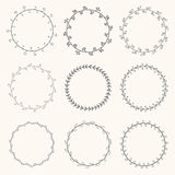 Collection of hand drawn vector round wreaths. Decorative elemen Stock Images