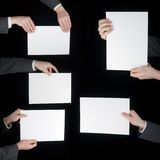 Collection of hand holding blank paper on black Stock Image