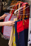 Collection of handbags on stall at the bazaar Royalty Free Stock Photography