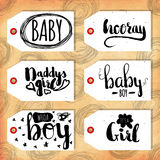 Collection handdrawn in the style of the lovely ready-made gift tags. Congratulations to mom and dad with a son and a daughter. Ve Stock Photography