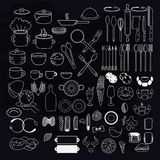 Kitchen utensils symbols on blackboard. royalty free illustration