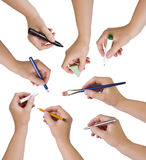 Collection of hands holding different stationary objects. Studio isolated Royalty Free Stock Photos