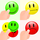 Collection of hands holding smiley faces Stock Photo