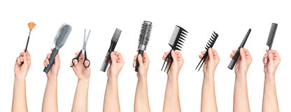 Collection of hands holding tools for hair salon Royalty Free Stock Image