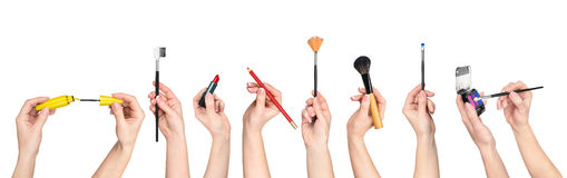 Collection of hands holding tools for makeup Stock Photography