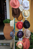 Collection of hats on a rack. Collection of hats different colors on the rack Royalty Free Stock Photos