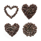 Collection of heart shape roasted coffee beans and coffee beans pile. Royalty Free Stock Photography