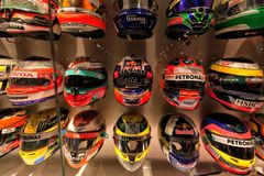 Collection of helmets of other pilots with whom Fernando Alonso. Exchanged his. Photograph taken on October, 2017 at the Fernando Alonso Museum in Spain Royalty Free Stock Photography