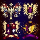 Collection of heraldic shields with golden swirls, crowns and ri Royalty Free Stock Images