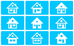 A collection of house icons on a blue background Royalty Free Stock Photo