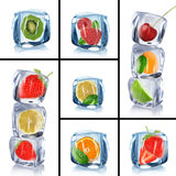 Ice cubes with frozen fruits Stock Photography