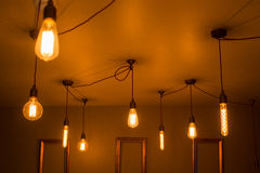 A Collection of Illuminated Light Bulbs on a Ceiling Stock Image