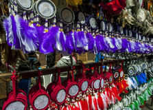 A collection of Indian tokens for sale at the Indian Market in Otavolo in Ecuador. Stock Photos