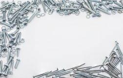 A Collection Of Iron Screws, Nuts, Nails And Lockwashers Above And Below Royalty Free Stock Images