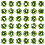 Collection of 36 isolated green icons on white background - alphabet and numerals. Computer generated collection of 36 isolated green icons on white background Royalty Free Stock Photos