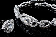 Jewelry. Collection of jewelry on black background stock images