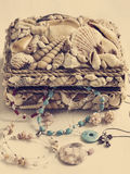 Collection of jewelry in jewelry box decorated with seashells Stock Images