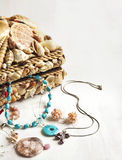 A collection of jewelry in jewelry box decorated with seashells Stock Photo